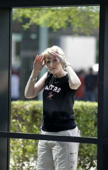 Louise Goren looks through the window near the Crawford Boxes as she waits for the gates to open bef
