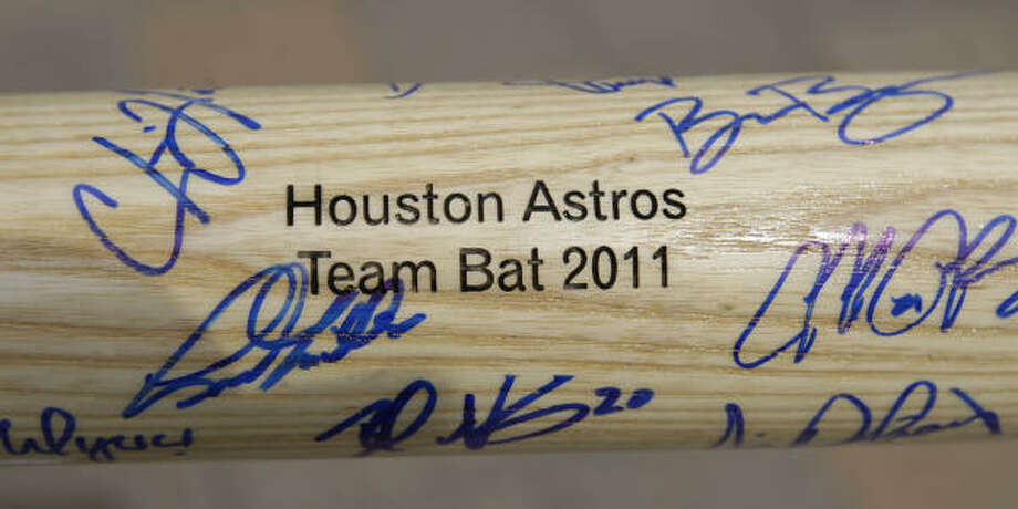 Phil Morales' bat is already covered in autographs from players on this year's Astros team. Photo: Karen Warren, Chronicle