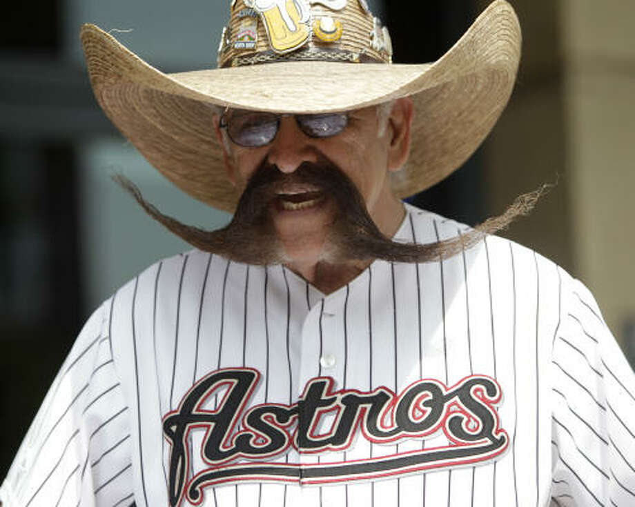 Valentin Jalomo, of Houston, sports his mustache and Astros jersey. Photo: Karen Warren, Chronicle
