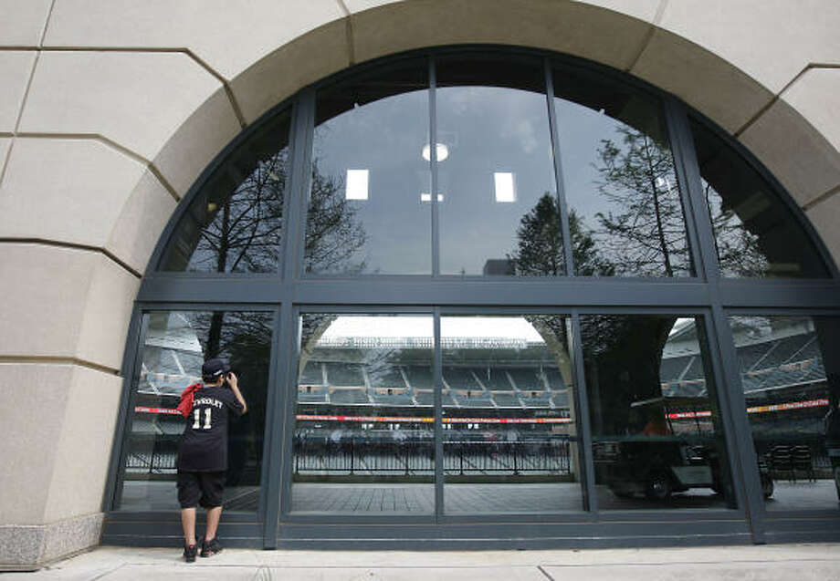 Matthew Ibarra, 13, peers through the windows at Minute Maid Park. Photo: Karen Warren, Chronicle