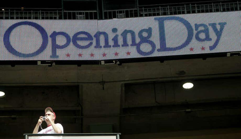 A fan takes photos during batting practice. Photo: Karen Warren, Chronicle