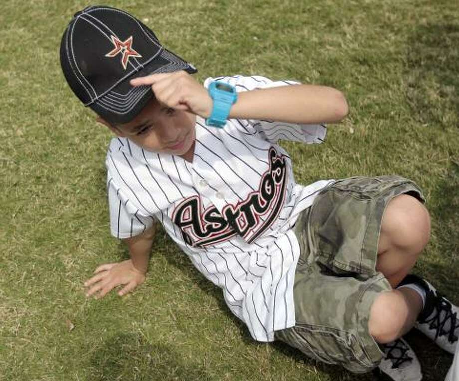 Astros fan nine year-old Caleb Guerrero enjoys the scene during the  Tenth Annual Opening Day Street Festival outside Minute Maid Park in Houston, Texas. The Houston Astros are matching up with the Florida Marlins in their home opener. Photo: Billy Smith II, Chronicle