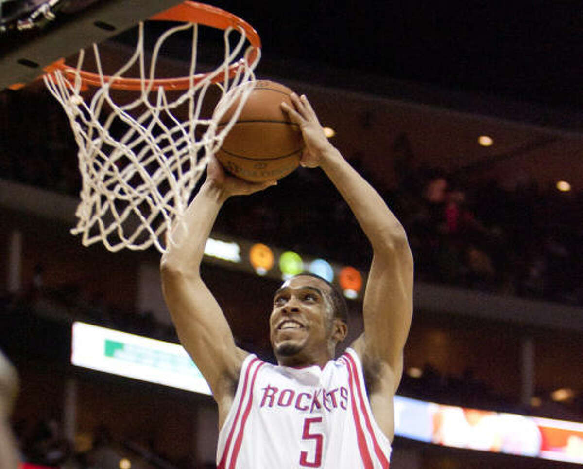 Rockets forward Courtney Lee (5) drives in and finishes with a dunk Saturday night against the Los Angeles Clippers.