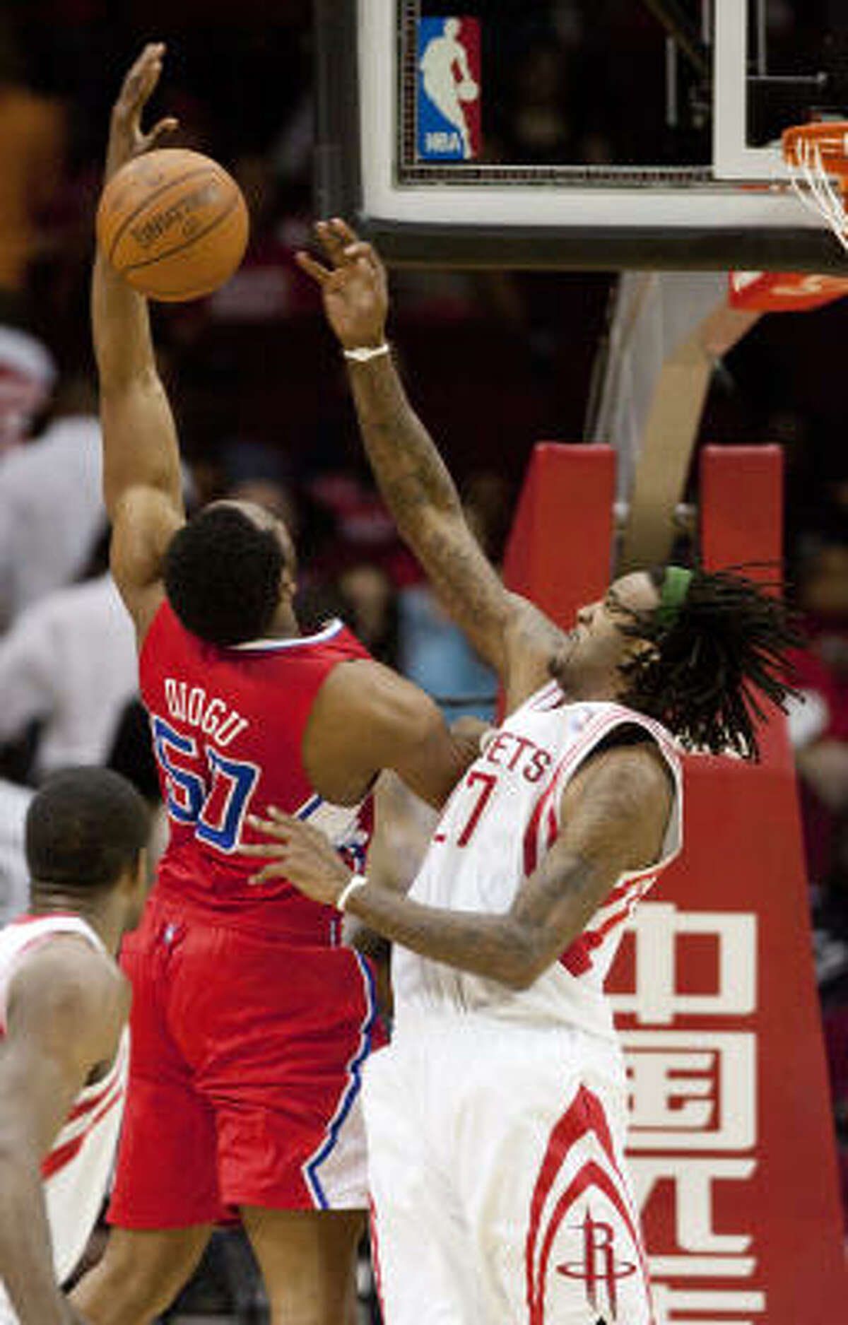 Houston Rockets forward, Jordan Hill, right, blocks a shot by Los Angeles Clippers forward Ike Diogu (50) in the second half. Houston defeated Los Angeles 99-78.