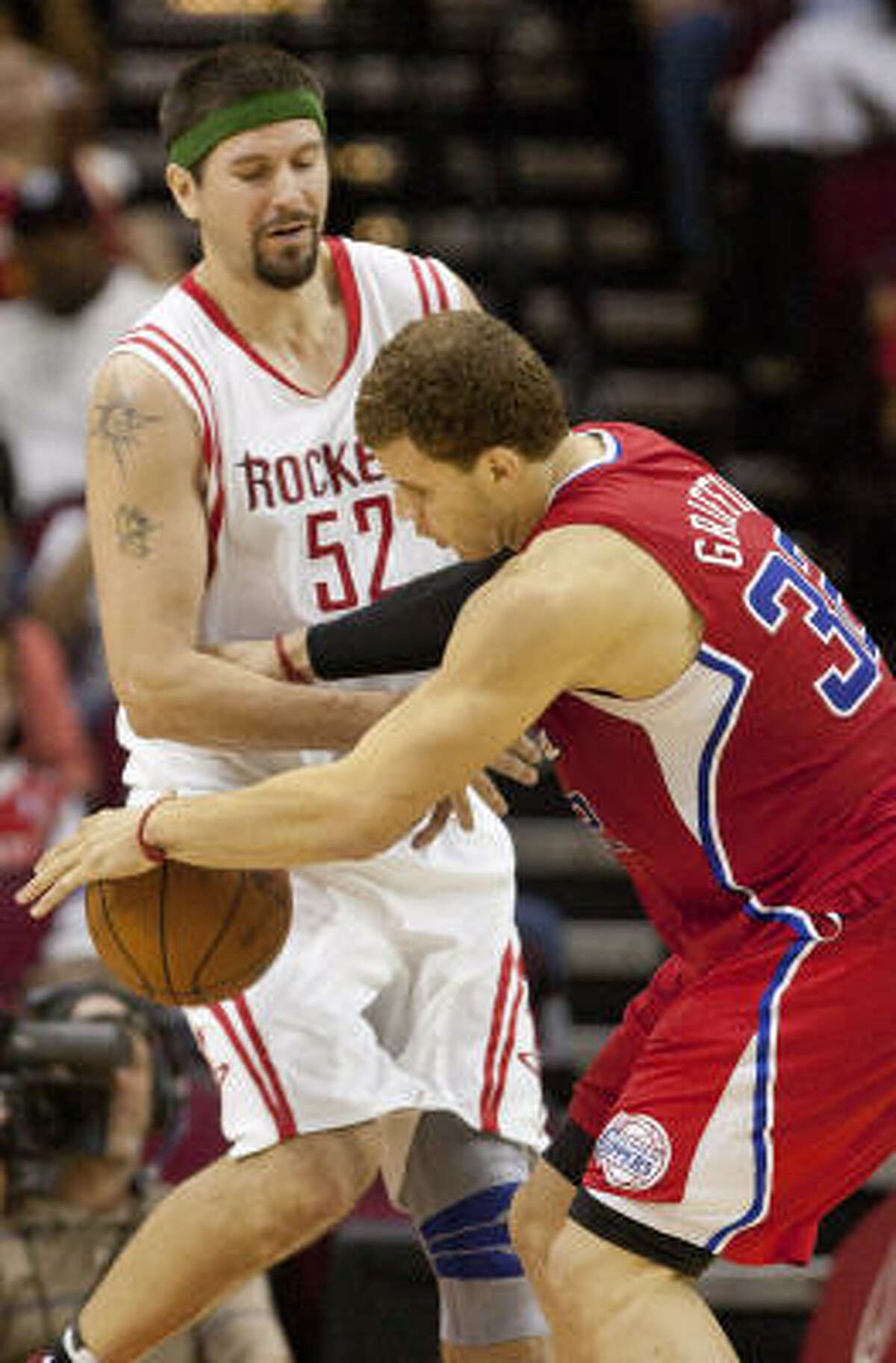 Houston Rockets center Brad Miller (52) knocks the ball loose from the hands of Los Angeles Clippers forward Blake Griffin (32).