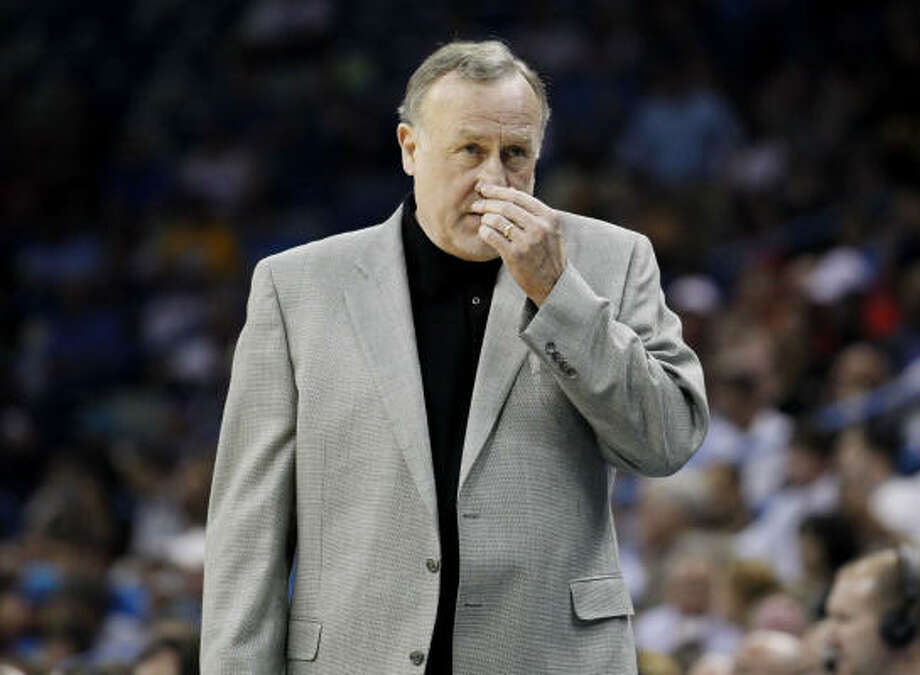 Rockets head coach Rick Adelman walks along the bench. Photo: Gerald Herbert, AP
