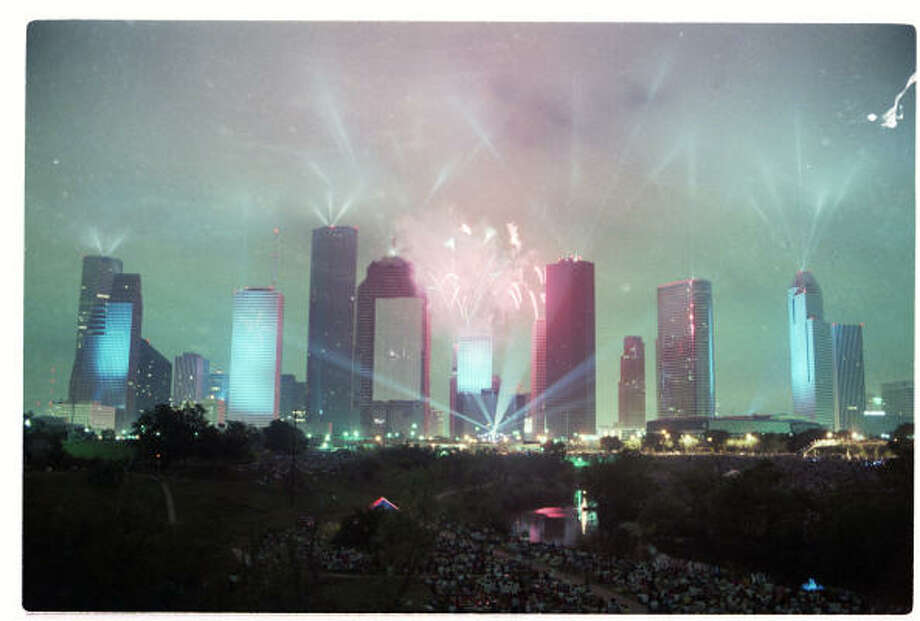 "Fireworks burst over the Houston skyline, laser beams play through the night sky and the city's buildings become screens for slides during Jean-Michel Jarre's ""Rendezvous Houston: A City In Concert"" laser light show on Saturday, April 5, 1986. Photo: Larry Reese, Chronicle File"