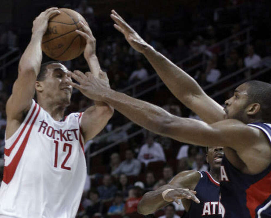 Rockets guard Kevin Martin (12) is fouled by Atlanta Hawks forward Al Horford, right, in the second half. Photo: Pat Sullivan, AP