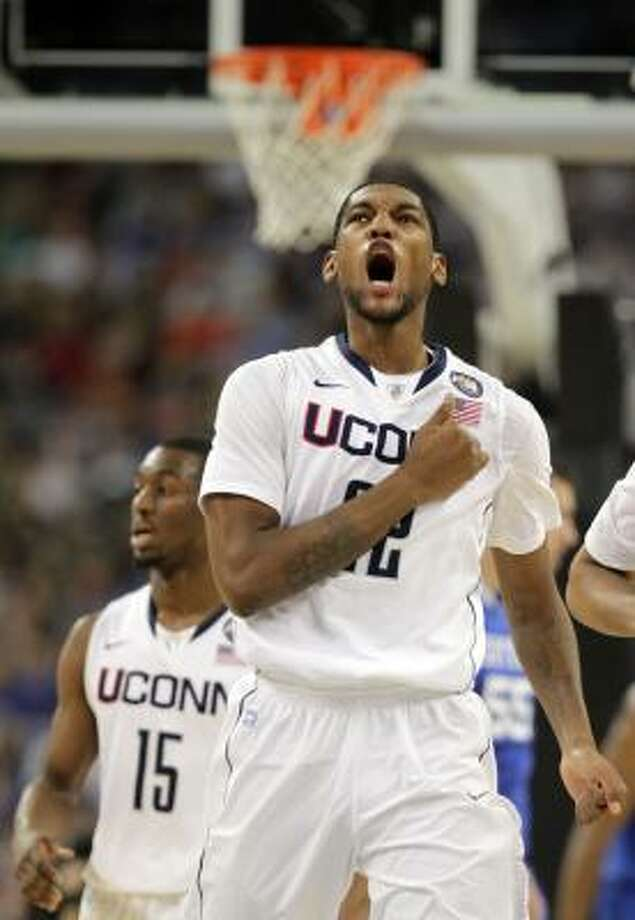 Connecticut forward Roscoe Smith (22) celebrates after making a shot. Photo: Karen Warren, Houston Chronicle