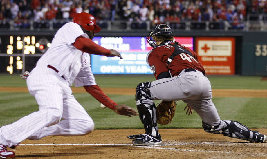 Philadelphia Phillies' Ryan Howard, left, slides past Houston Astros catcher J.R. Towles to score on a RBI-single by Ben Francisco in the fifth inning of a baseball game, Saturday, in Philadelphia. Philadelphia won 9-4. Photo: Matt Slocum, AP
