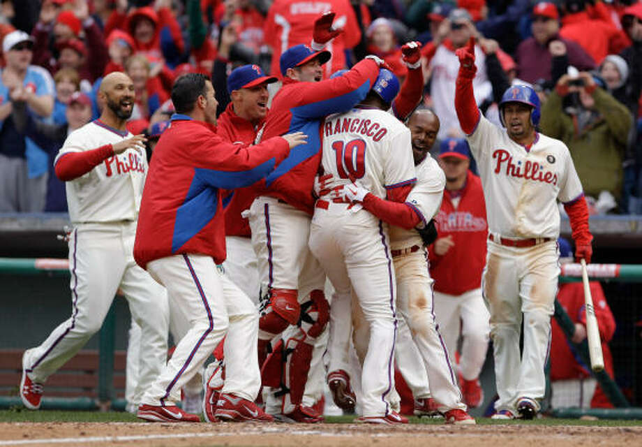 Ben Francisco #10 of the Philadelphia Phillies is mobbed by teammates after scoring the winning run against the Houston Astros during the ninth inning at Citizens Bank Park on April 1, in Philadelphia, Pennsylvania. The Phillies won 5-4 Photo: Rob Carr, Getty Images