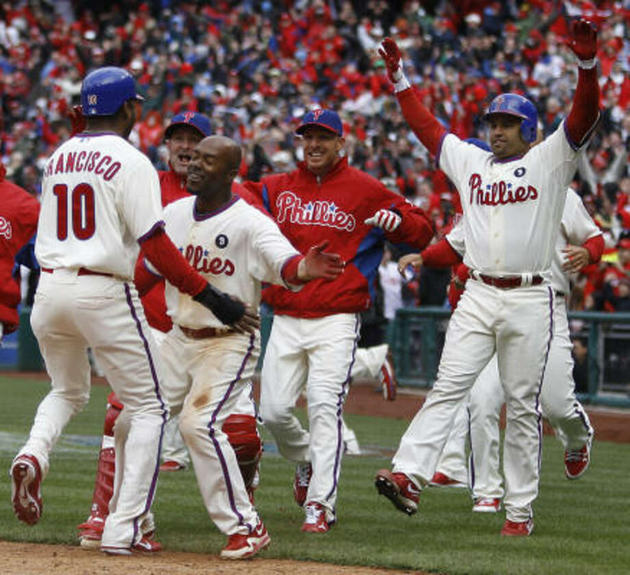 Philadelphia Phillies' Ben Francisco, from left, celebrates with teammates Brian Schneider, Jimmy Rollins, Roy Halladay and Placido Polanco after scoring the game-winning run on an RBI-single by John Mayberry Jr. in the ninth inning of an opening day baseball game against the Houston Astros, Friday, in Philadelphia. The Phillies won 5-4. Photo: Matt Rourke, AP