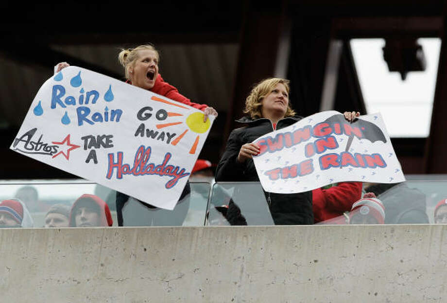 Philadelphia Phillies fans hold up signs during the seventh inning of the Philadelphia Phillies and Houston Astros opening day game at Citizens Bank Park on April 1, in Philadelphia, Pennsylvania. Photo: Rob Carr, Getty Images