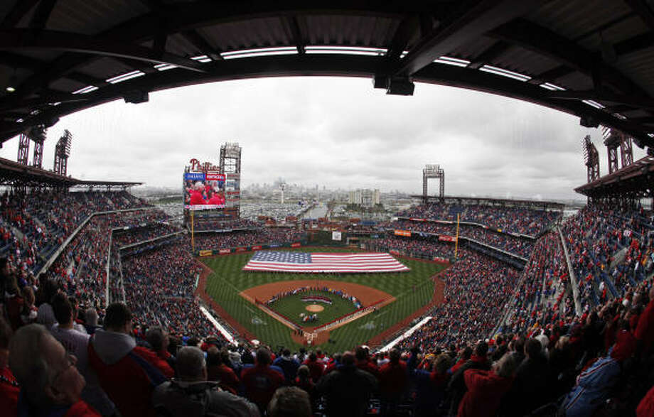 Fans and players stand as the national anthem is performed before the opening day baseball game between the Philadelphia Phillies and the Houston Astros in Philadelphia. Photo: Matt Rourke, AP
