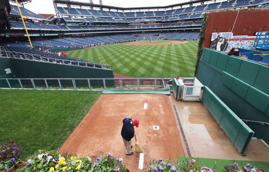 A grounds keeper sweeps the mound in the bullpen before the start of the opening day game between the Philadelphia Phillies and Houston Astros at Citizens Bank Park in Philadelphia, Penn. Photo: Rob Carr, Getty Images