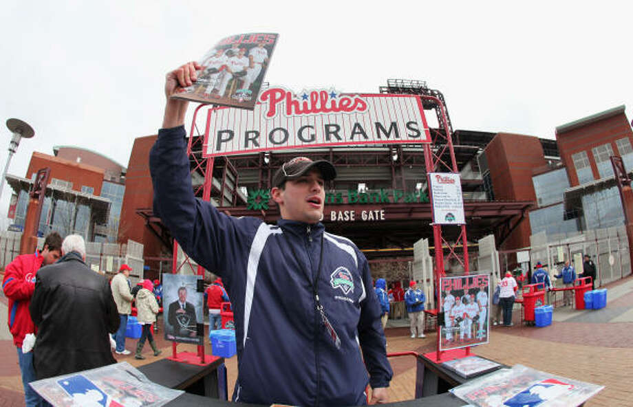 David Uram sells programs outside of Citizens Bank Park before the opening day game between the Philadelphia Phillies and Houston Astros. Photo: Rob Carr, Getty Images