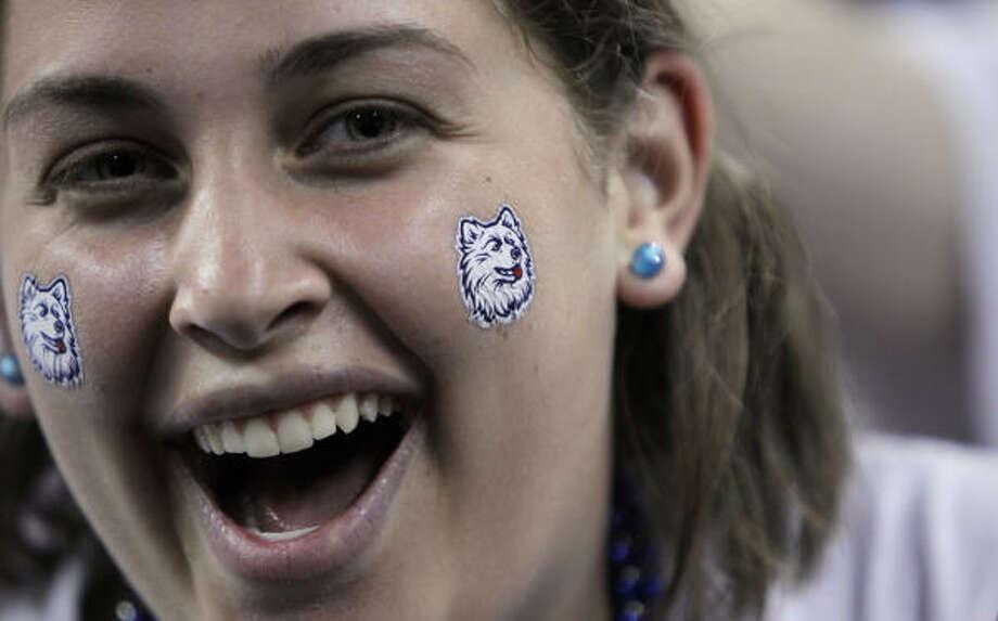 A Connecticut fan cheers her team against Kentucky. Photo: Karen Warren, Houston Chronicle