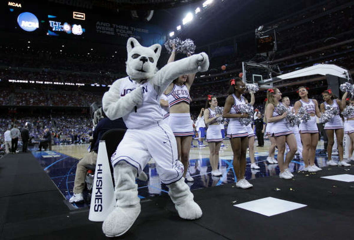 The Connecticut mascot performs with the team cheerleaders against Kentucky during the first half of the NCAA National Semifinals.