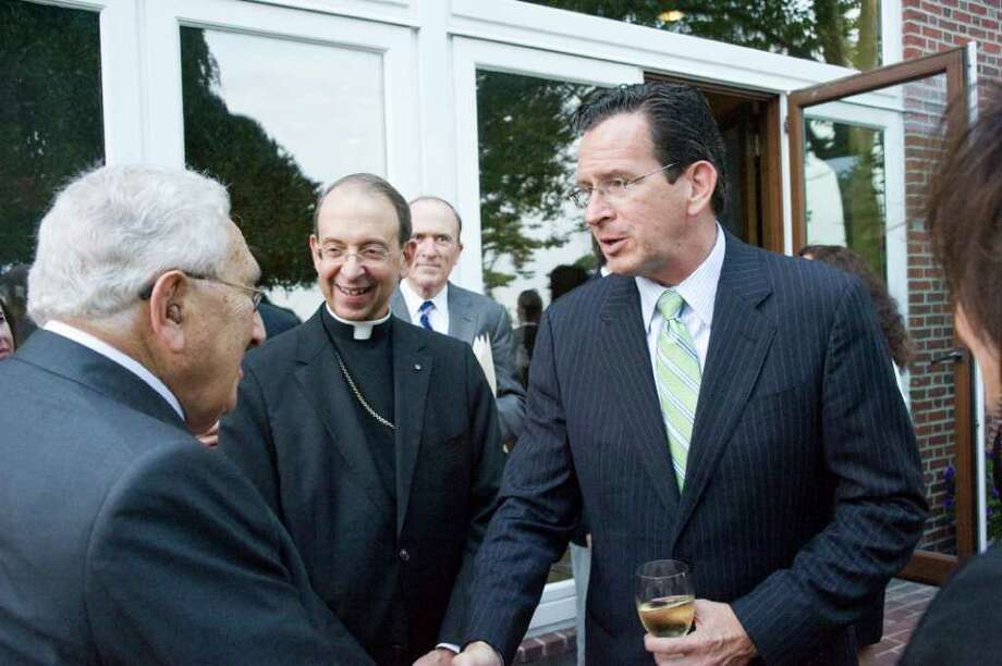 "Governor Dannel P. Malloy greets Nobel Prize winner and former Secretary of State Henry Kissinger as Bishop Lori looks on at Robert Dilenschneider's home in Darien, Conn., July 28, 2011. Kissinger discussed his new book ""On China."" Photo: Keelin Daly / Stamford Advocate"