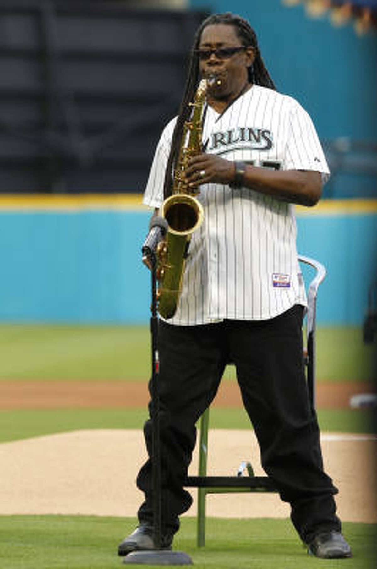 Clarence Clemons performs the national anthem before an opening day baseball game between the Florida Marlins and the New York Mets in Miami, Friday, April 1, 2011.