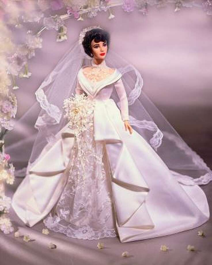 Elizabeth Taylor, who has died at age 79, was as famous for her numerous walks down the aisle as for her movies. A Mattel doll even featured Taylor with veil and bouquet in Father of the Bride, a film that came out just days after she got married for the first time at age 18. She married eight times in all. Here's a look at those marriages.  Associated Press reporter Bob Thomas contributed to this report. Photo: 2000 Mattel Photo