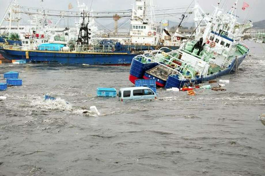 Fishing boats and cars are caught up in a tsunami wave at the Japanese port city of Iwaki, in northern Japan's Fukushima prefecture. Photo: FUKUSHIMA MINPO, AFP/Getty Images