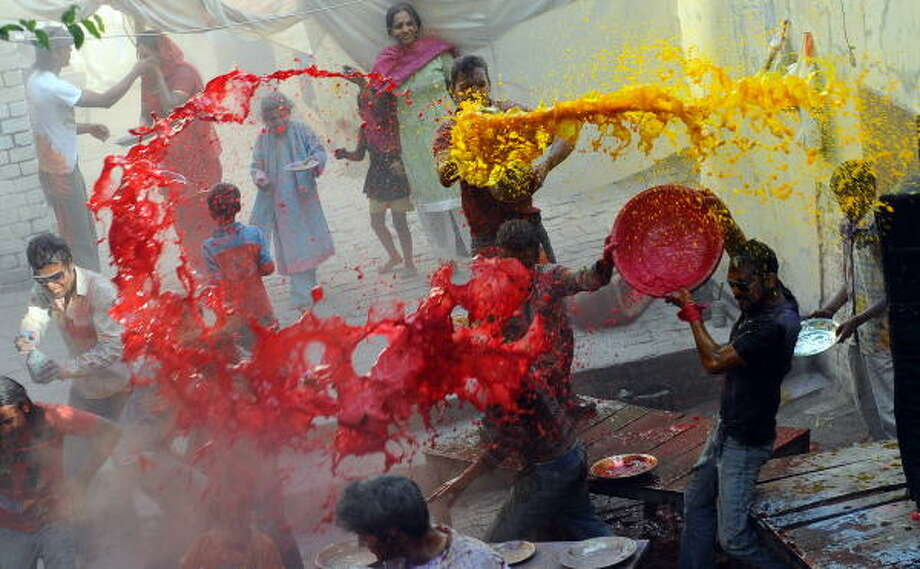 Pakistani Hindus fling water during Holi. In areas with a large Hindu population, the celebrations take over, and Hindus have free reign to play in the streets. Photo: ARIF ALI, AFP/Getty Images
