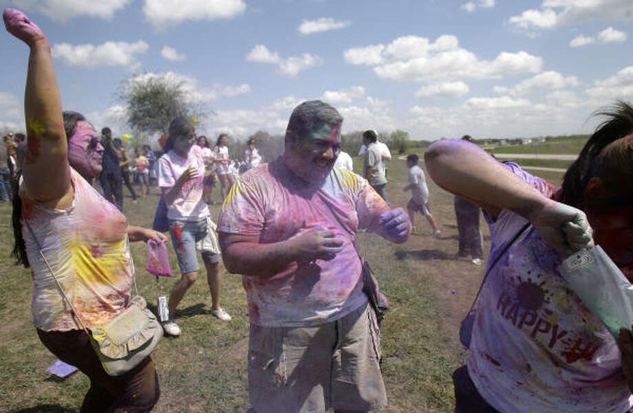 "Attendees toss the powders on each other, living by the mantra Bura na mano, Holi Hai - ""Don't mind, it's Holi!"" Photo: Cody Duty, Houston Chronicle"