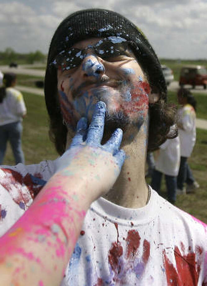 "Ben Newberry gets covered in the colored stuff, called ""rang."" Photo: Cody Duty, Houston Chronicle"