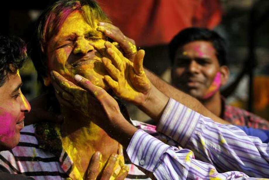Indian students smear their faces with colored powder during Holi festivities in Allahabad, India. Photo: Rajesh Kumar Singh, AP