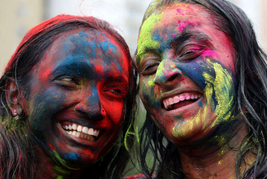 Two participants smile during the Holi festival in Kuala Lumpur, Malaysia. Photo: Lai Seng Sin, AP