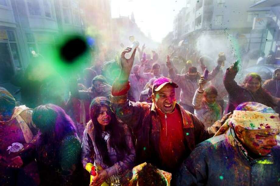 Hindus get crazy and messy in the streets of the Hague. Photo: ROBIN UTRECHT, AFP/Getty Images