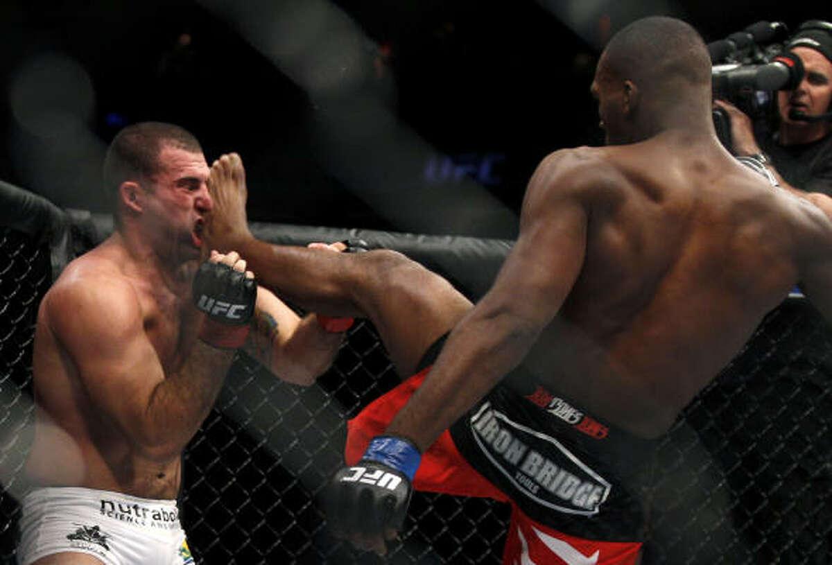 Jon Jones, right, kicks Mauricio Rua during their light heavyweight title fight. Jones won by TKO.