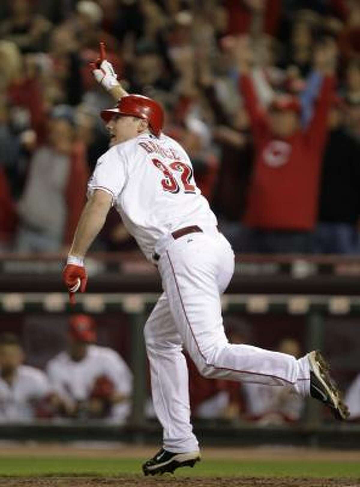Cincinnati Reds' Jay Bruce reacts after hitting a home run off Houston Astros relief pitcher Tim Byrdak in the ninth inning of a baseball game Tuesday, Sept. 28, 2010, in Cincinnati. Cincinnati clinched the NL Central with a 3-2 win.