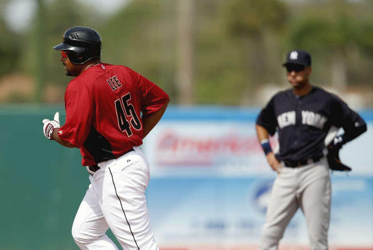 March 6: Yankees 10, Astros 8 Yankees shortstop Derek Jeter watches Astros left fielder Carlos Lee round second base after his third-inning homer.