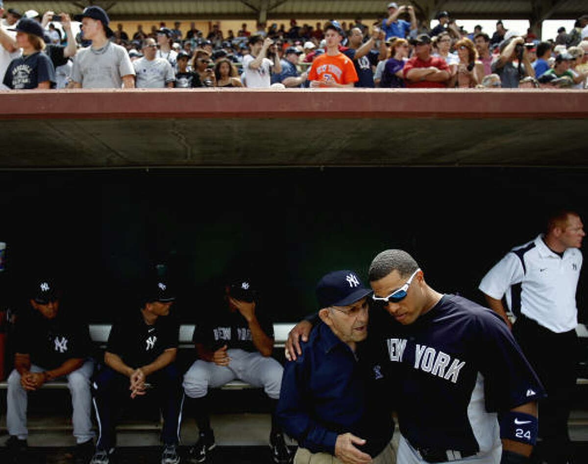 Yankees second baseman Robinson Cano, right, speaks with Hall of Fame Yankee catcher Yogi Berra before the start of the game against the Astros.