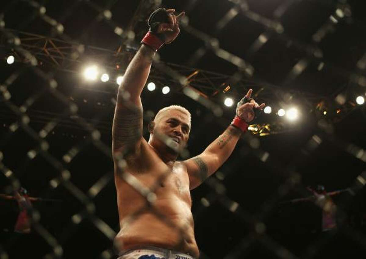 Mark Hunt celebrates his win over Chris Tuchscherer during their heavyweight bout.