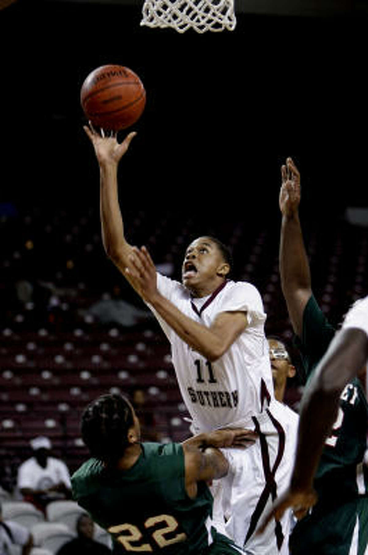 Texas Southern guard Lawrence Johnson-Danner (11) shoots over Mississippi Valley State forward Orlando Smith (22).