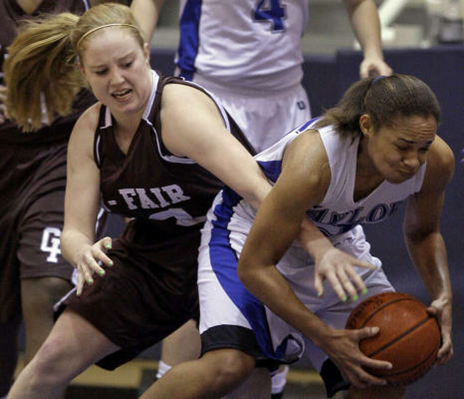 Feb. 17: Katy Taylor 79, Cy-Fair 59 Cy-Fair's Erin Shepard, left, reaches to steal ball from Katy Taylor's Jada Roberts during the second quarter of Thursday's Region III-5A playoff game at Coleman Coliseum. Photo: Melissa Phillip, Chronicle