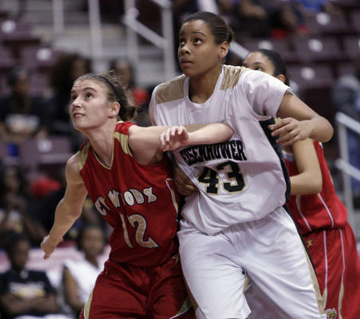 Cy Woods' Jennifer Nash (12) and Eisenhower's Ashley Charles (43) hook up during a play.