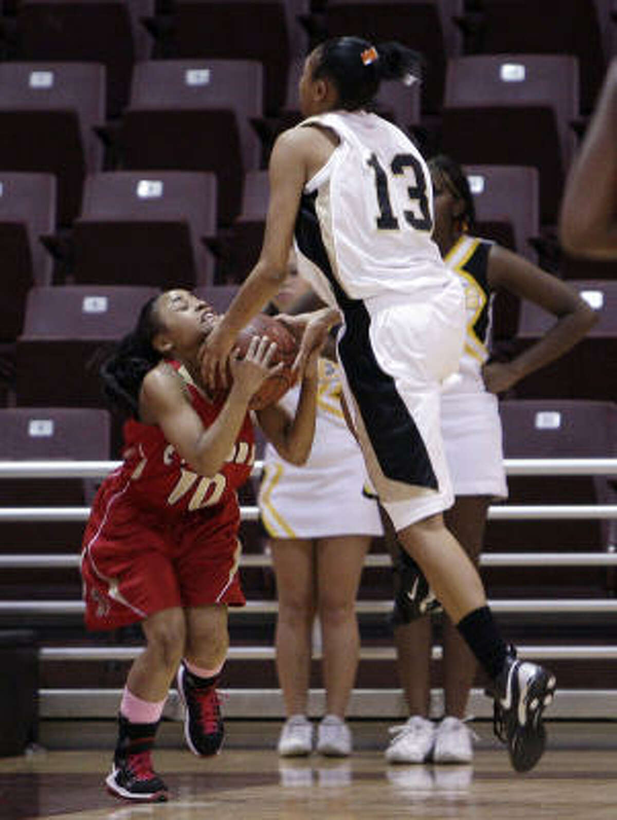 Cy Wood's Chelsi Grimes (10) ties up Eisenhower's Taylor Overshown (13).
