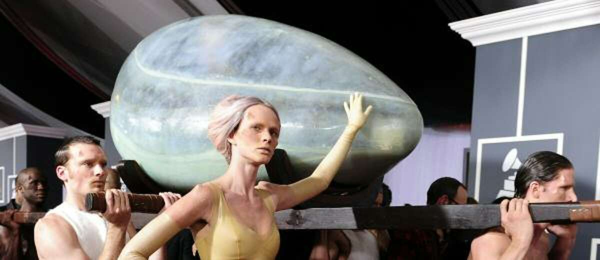An egg-like container with singer Lady Gaga inside arrives for the 53rd Annual Grammy Awards at the Staples Center in Los Angeles.