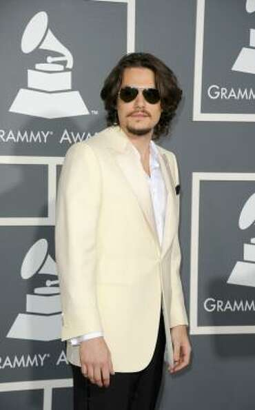 Singer-songwriter John Mayer arrives at The 53rd Annual GRAMMY Awards held at Staples Center.