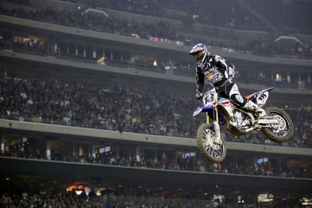 Davi Millsaps, who finished fourth in the AMA Supercross main event, flies to the finish line in an earlier heat race.