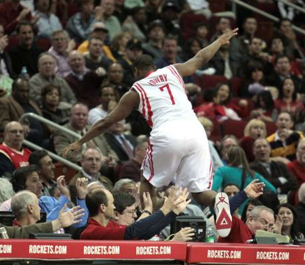 After being shoved off the court, Houston Rockets guard Kyle Lowry (7) leaps into the crowd in the fourth quarter of the Houston Rockets match-up with the Los Angeles Clippers at Toyota Center in Houston, Texas.