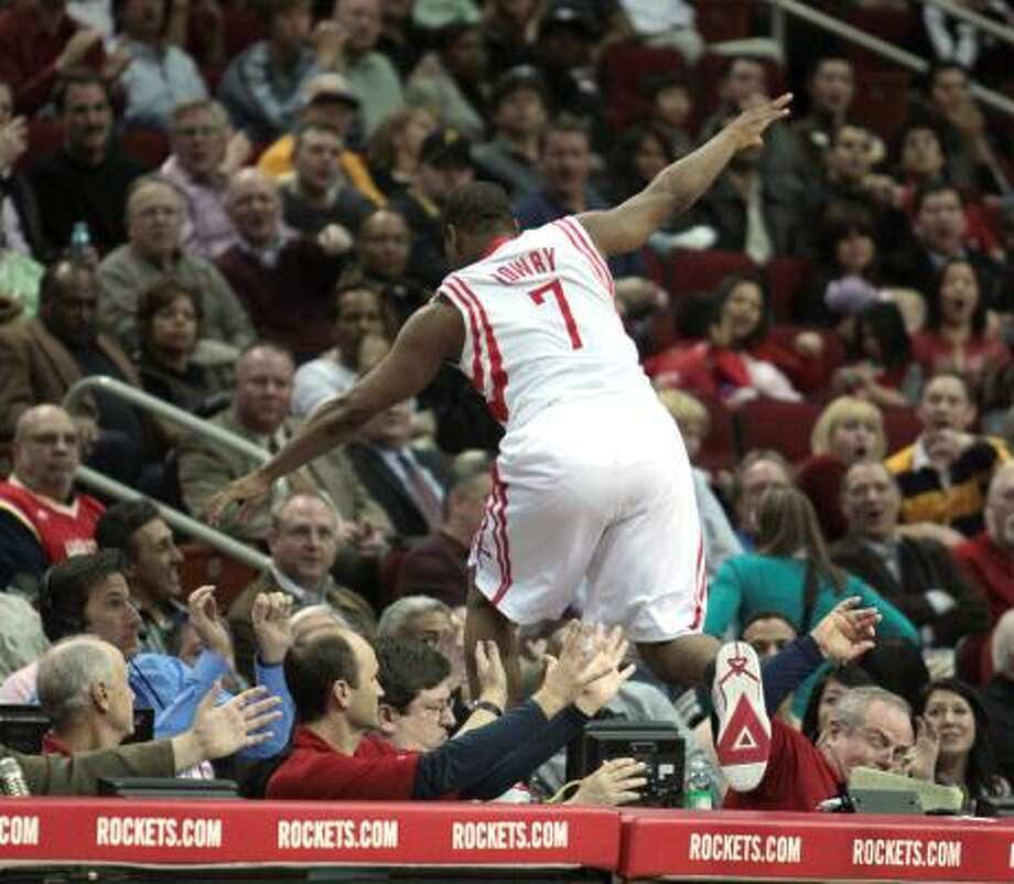 After being shoved off the court, Houston Rockets guard Kyle Lowry (7) leaps into the crowd in the fourth quarter of the Houston Rockets match-up with the Los Angeles Clippers at Toyota Center in Houston, Texas. Photo: Billy Smith II, Houston Chronicle