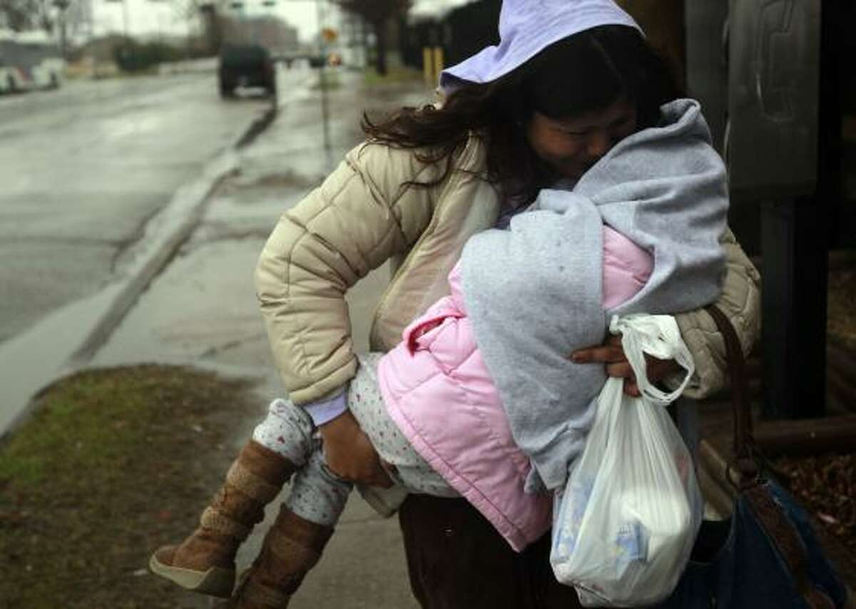 Reyna Martinez, took her daughter to another business down the road to keep her warm until the facility opened.