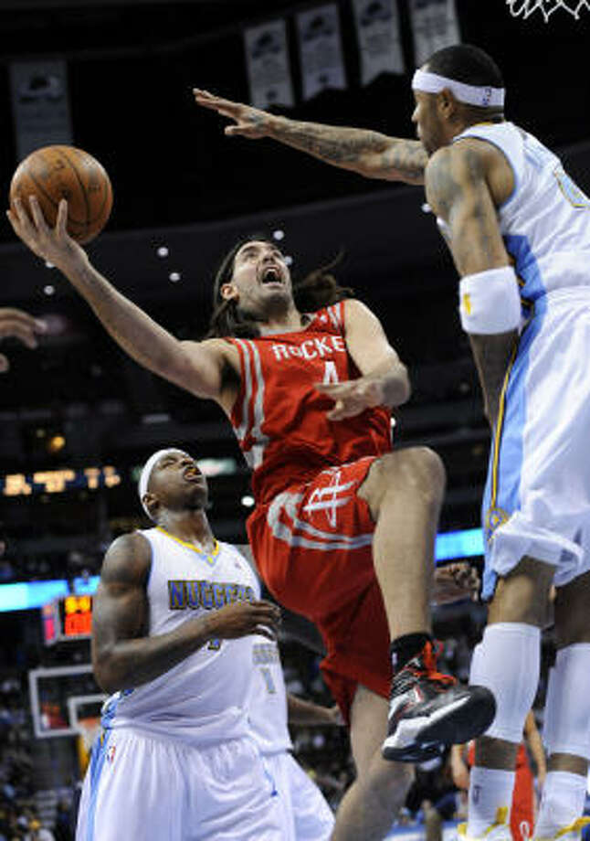 Rockets forward Luis Scola (4) goes up for a shot against Nuggets forward Kenyon Martin (4) as Al Harrington (7) watches the play. Photo: Jack Dempsey, AP