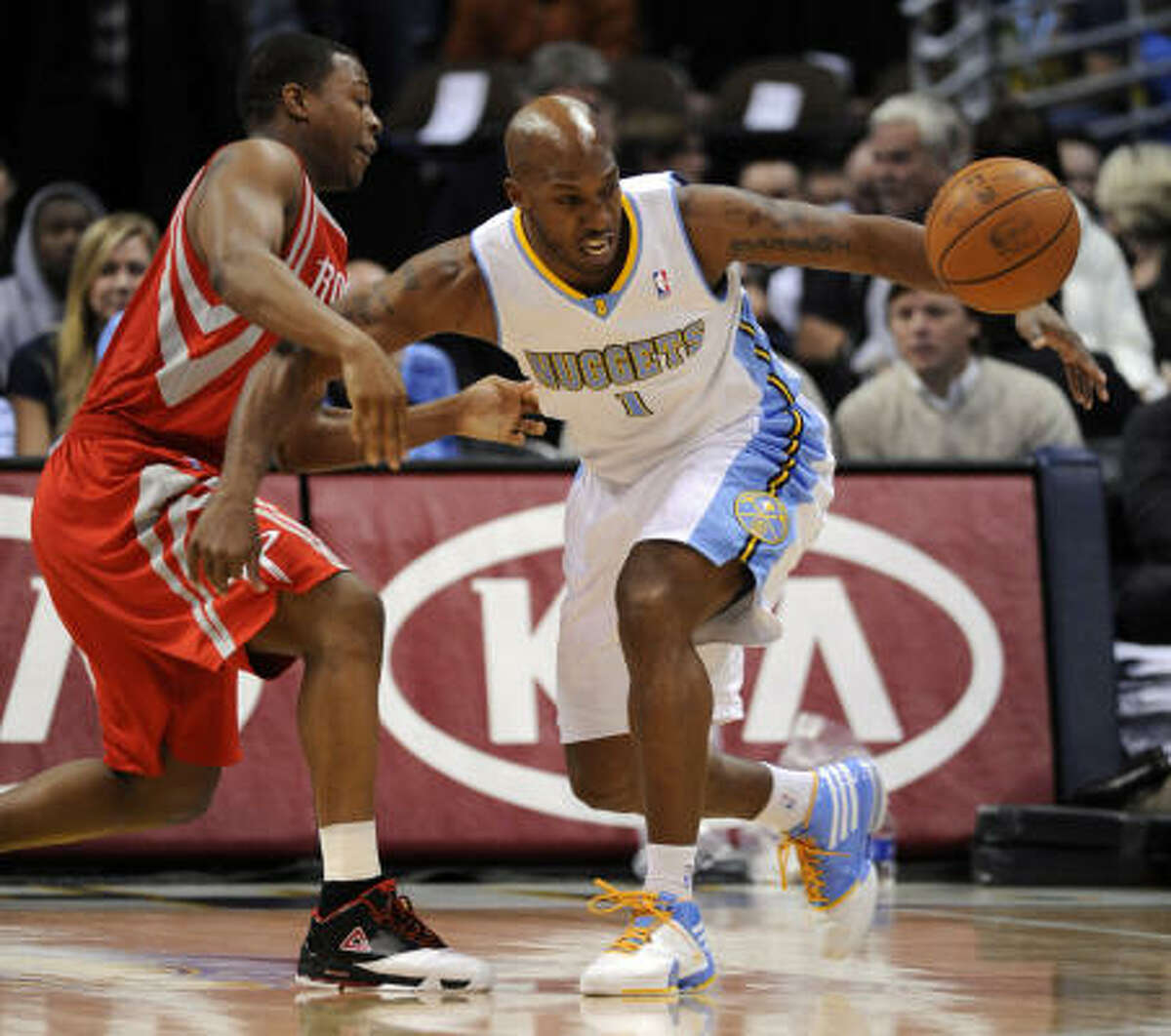 Nuggets guard Chauncey Billups (1) loses control of the ball against Rockets guard Kyle Lowry (7).