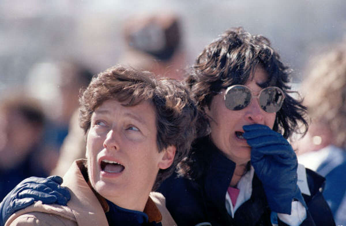 In this Jan. 28, 1986 file photo, two spectators at the Kennedy Space Center, at Cape Canaveral, react to the explosion.